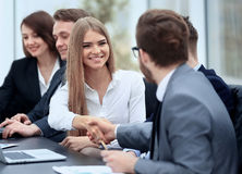 Business people in formalwear sitting at the table Royalty Free Stock Photo