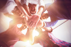 Business people forming hands stack. At office royalty free stock images