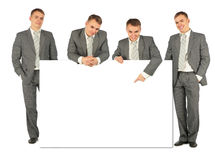 Business people of four with board for text Royalty Free Stock Images