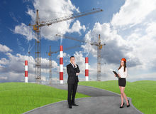 Business people in front af a factory Stock Images
