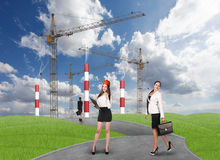 Business people in front af a factory Royalty Free Stock Photos