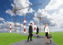 Business people in front af a factory Royalty Free Stock Image
