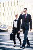 Business people in front of office building Stock Images