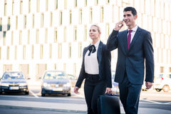 Business people in front of office building Stock Photo