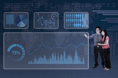 Business people with futuristic interface Stock Photography