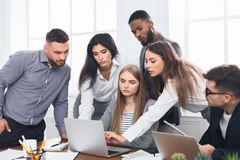 Business people gathered around laptop discussing ideas royalty free stock photos