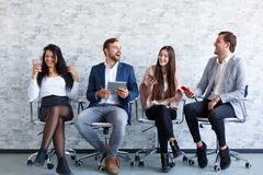 Business people at a conference in the office with phones in hands royalty free stock photography