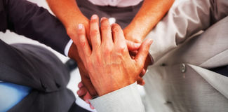 Business people gathering their hands together Stock Image