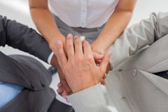 Business people gathering their hands together. In the workplace Royalty Free Stock Images