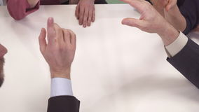 Business people gesture at the table stock footage