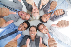 Business people gesturing thumbs up Stock Photos