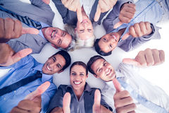 Business people gesturing thumbs up Royalty Free Stock Photos