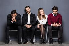 Business People Are Getting Bored While Sitting On Chair Waiting For Job Interview In Office stock photography