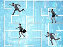 Business people getting lost in maze uncertainty concept stock photos