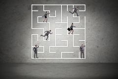 The business people getting lost in maze uncertainty concept. Business people getting lost in maze uncertainty concept Royalty Free Stock Photography