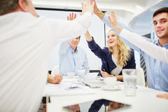 Business people give each other a high five Royalty Free Stock Photos