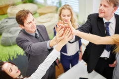 Business people give each other a high five in the office Stock Photo