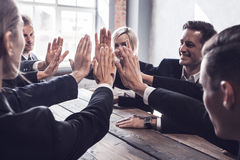Business people give high five Stock Photography