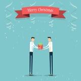 Business people giving Christmas gift to business partner. Giving Christmas gift for merry Christmas Stock Image