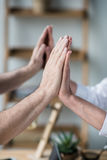 Business people giving double high five to each other Royalty Free Stock Photos