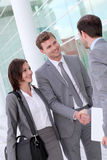 Business people giving handshakes Stock Photo