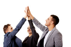 Business people giving high five Stock Photography
