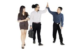 Business people giving high five hands on studio. Picture of young business people giving high five hands gesture after meeting , isolated on white background Royalty Free Stock Photo