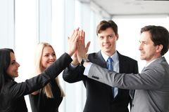 Business people giving high five Stock Image
