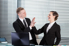 Business people giving high five Royalty Free Stock Images
