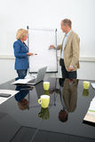 Business people giving presentation Royalty Free Stock Photography