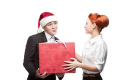 Business people giving red christmas gift Stock Image