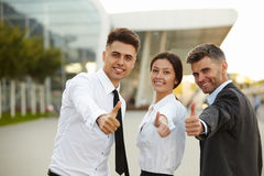 Business people giving thumbs up. Business Team Stock Photos