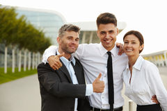 Business people giving thumbs up. Business Team Royalty Free Stock Photos