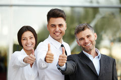 Business people giving thumbs up. Business Team Royalty Free Stock Photography