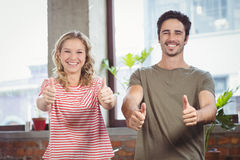 Business people giving thumbs up Royalty Free Stock Photography