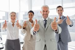 Business people giving thumbs up Stock Photos