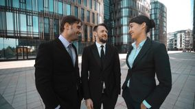 Business people glad to see You. Handshake. Hello. 4K. UHD, POV. Three young attractive successful business people in formal suits glad to see You. Handshake stock footage