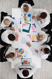 Business people and graphs Stock Photos