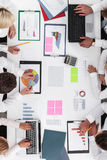 Business people and graphs Stock Image