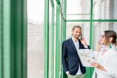 Business people in the green hall royalty free stock image