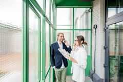 Business people in the green hall royalty free stock photography