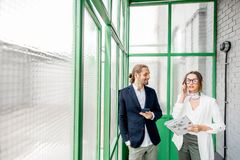 Business people in the green hall royalty free stock photo