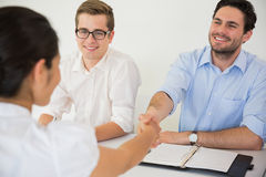 Business people greeting in meeting Stock Photo