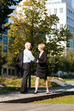 Business people greeting outdoors Royalty Free Stock Image