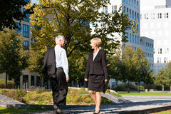 Business people greeting outdoors Royalty Free Stock Photos