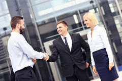 Business people greeting outside modern building Royalty Free Stock Photos