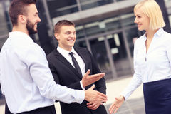 Business people greeting outside modern building Royalty Free Stock Images
