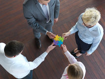 Business people group assembling jigsaw puzzle Royalty Free Stock Image