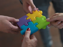 Business people group assembling jigsaw puzzle Stock Image