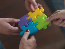 Business people group assembling jigsaw puzzle Royalty Free Stock Photography